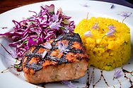 Fresh Alaskan salmon, shoyu glaze, golden rice and Asian slaw at The Flats Bistro, Kenai, Alaska, USA<br /> <br /> Photographer: Christina Sjögren<br /> <br /> Copyright 2019, All Rights Reserved