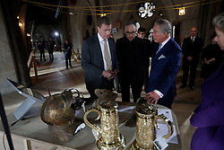 The Prince of Wales is shown artefacts by Dr Tony Trowles (left) the head of collections, flanked by the Dean of Westminster John Hall (centre) during his visit to the The Queen's Diamond Jubilee Galleries at Westminster Abbey in London.
