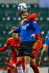 TALLINN, ESTONIA - Monday, October 11, 2021: Estonia's Sergei Zenjov challenges for a header with Wales' Chris Mepham during the FIFA World Cup Qatar 2022 Qualifying Group E match between Estonia and Wales at the A. Le Coq Arena. Wales won 1-0. (Pic by David Rawcliffe/Propaganda)