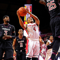 Myles Mack #4 of the Rutgers Scarlet Knights puts a shot up against Quenton DeCosey #25 of the Temple Owls during Rutgers men's basketball vs Temple Owls in American Athletic Conference play on Jan. 1, 2014 at Rutgers Louis Brown Athletic Center in Piscataway, New Jersey.