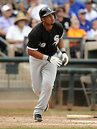 SURPRISE, AZ - MARCH 06:  Jose Abreu #79 of the Chicago White Sox hits a two-run home run, his first as a member of the Chicago White Sox,  against the Kansas City Royals on March 6, 2014 at The Ballpark in Surprise in Surprise, Arizona. (Photo by Ron Vesely)   Subject: Jose Abreu