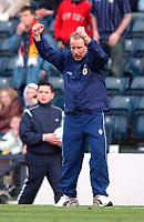 Photo. Richard Lane<br />Scotland v Iceland. Euro 2004 Qualifying Match at Hampden Park. 29/03/2003.<br />Berti Vogts celebrates victory over Iceland.