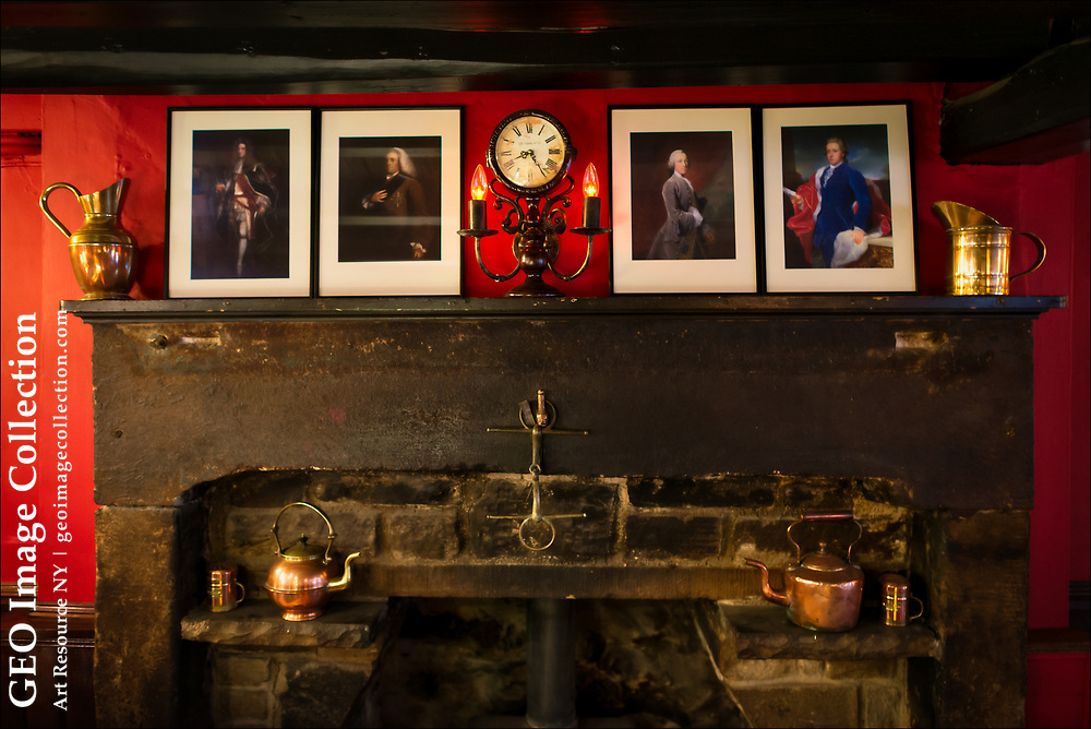 """The rustic fireplace and furnishings at the Devonshire Arms Inn in Yorkshire Dales National Park testifies to its  sixteenth century origins.  The so-called """"country house hotel"""" near Skipton has a bar that attracts as many locals as tourists."""