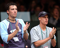 Lleyton Hewitt claps a winning point by his girlfriend Kim Clijsters in her game with Venus Williams. Wimbledon Tennis Championship, Day 10, 3/07/2003. Credit: Colorsport / Matthew Impey DIGITAL FILE ONLY