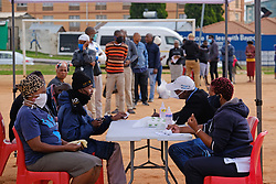 ALEXANDRA SOUTH AFRICA - APRIL 25: Residents in a que during intensified testing and screening on Freedom Day, screening and testing includes people over over 60, flu-like symptoms, comorbid conditions, like diabetes, asthma, hypertencsion, HIV and tuberculosis on April 25, 2020 in Alexandra South Africa. Under pressure from a global pandemic. President Ramaphosa declared a 21 day national lockdown extended by another two weeks, mobilising goverment structures accross the nation to combat the rapidly spreading COVID-19 virus - the lockdown requires businesses to close and the public to stay at home during this period, unless part of approved essential services. (Photo by Dino Lloyd)
