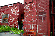 SHOT 7/8/14 1:03:46 PM - Deteriorating buildings at the closed RND Machine shop in Buffalo, N.Y. RND was a machine shop providing general & CNC machining, drilling & boring, lathe & mill work. Buffalo, N.Y. is the second most populous city in the state of New York. Located in Western New York on the eastern shores of Lake Erie and at the head of the Niagara River across from Fort Erie, Ontario, Canada, Buffalo is the seat of Erie County and the principal city of the Buffalo-Niagara Falls metropolitan area, the largest in Upstate New York. By 1900, Buffalo was the 8th largest city in the country, and went on to become a major railroad hub, the largest grain-milling center in the country and the home of the largest steel-making operation in the world. The latter part of the 20th Century saw a reversal of fortunes: by the year 1990 the city had fallen back below its 1900 population levels. (Photo by Marc Piscotty / © 2014)