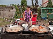 06 APRIL 2010 - NAKHON PHANOM, THAILAND: A woman fries chicken in the market in Nakhon Phanom, Thailand.    PHOTO BY JACK KURTZ