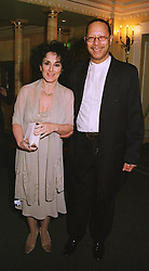 MR PETER STRAKER and actress LESLIE JOSEPH, at a dinner in London on 5th March 1999.MPB 17