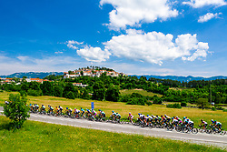 Peloton and in background town Stanjel during the 4th Stage of 27th Tour of Slovenia 2021 cycling race between Ajdovscina and Nova Gorica (164,1 km), on June 12, 2021 in Slovenia. Photo by Matic Klansek Velej / Sportida