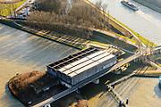 Nederland, Utrecht, Nieuwegein, 07-02-2018; Amsterdam-Rijnkanaal (onder) met plofsluis bij Jutphaas, onderdeel van de Nieuwe Hollandse Waterlinie. De voorziening diende om het kanaal af te kunnen dammen, een explosie met dynamiet zou de inhoud van de betonnen bak - zand en grind - in het kanaal doen belanden. Toenemende scheepvaart leidde er toe dat het kanaal om de sluis heen geleid werd. Lekkanaal rechts in beeld. <br /> 'Plof' sluice, explosion sluice, Dutch defense line; the installation was build to obstruct the canal: explosives would cause the sand and gravel from the concrete reservoirs to fall in the canal.<br /> <br /> luchtfoto (toeslag op standard tarieven);<br /> aerial photo (additional fee required);<br /> copyright foto/photo Siebe Swart