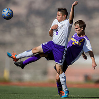 Miyamura Patriot Isaiah Murillo (6) and Kirtland Central Bronco Destry Palmer (5) compete for the ball Tuesday at Miyamura High School.