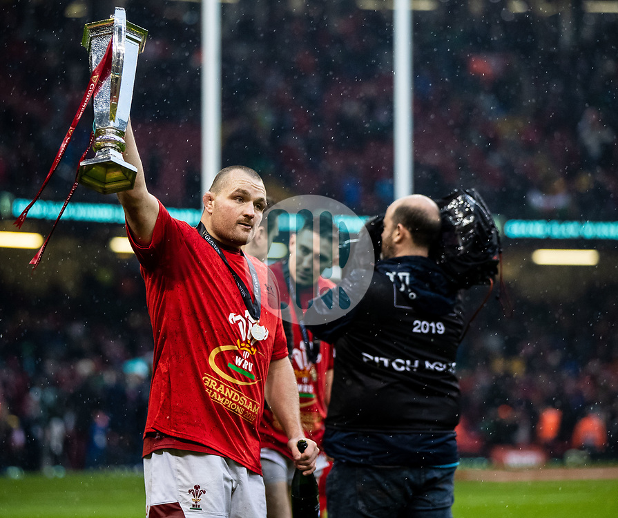 Ken Owens of Wales holds the Six Nations trophy aloft<br /> <br /> Photographer Simon King/Replay Images<br /> <br /> Six Nations Round 5 - Wales v Ireland - Saturday 16th March 2019 - Principality Stadium - Cardiff<br /> <br /> World Copyright © Replay Images . All rights reserved. info@replayimages.co.uk - http://replayimages.co.uk