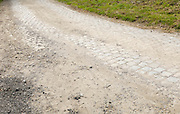 France, April 13th 2014: Detailed view of road surface near the exit of Pont Gibus, Wallers, just before the Paris Roubaix 2014 race came through.