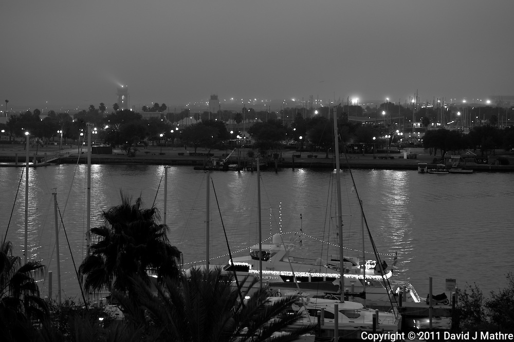 Misty View over Vinoy Basin in St Petersburg. Image taken with at Nikon D3 and 70-200 mm f/2.8 VR lens (ISO 200, 98 mm, f/4, 1/5 sec). Image converted to B&W with Lightroom Quick Develop B&W - Green Filter.