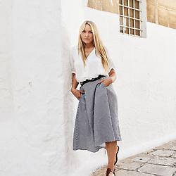 Collette Dinnigan, posing in a small street. Ostuni, Italia. September 28, 2019.