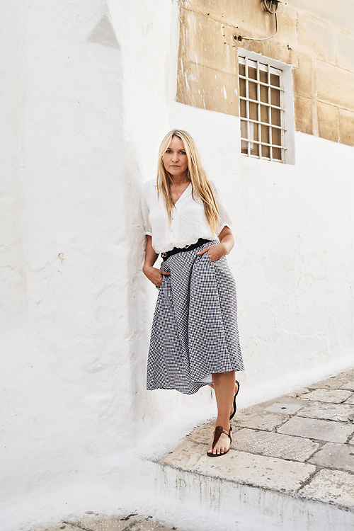 Collette Dinnigan, posing in a small street. Ostuni, Italia. September 28, 2019.