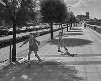 Sidewalk Skaters in Getxo Spain. Image taken with a Leica X2 camera (ISO 100, 24 mm, f/6.3, 1/2000 sec). Raw image processed with Capture One Pro, and Photoshop CC 2014