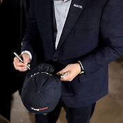 Democratic presidential candidate Andrew Yang signs a hat  for a supporter after a town hall at the Ideal Social Hall in Cedar Rapids, Iowa on Thursday, January 30, 2020.