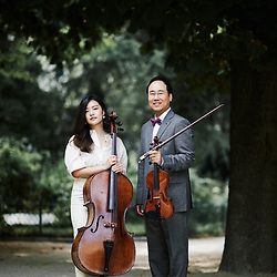 Violinist Hyung Joon Won and cellist Soomin Suh posing in the Maurice Gardette Square. Paris, France. July 1st, 2019.<br /> Le violoniste Hyung Joon Won et la violoncelliste cellist Soomin Suh, prenant la pose au square Maurice Gardette. Paris, France. 1er juillet 2019.