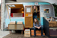 Creme Tangerine co-owners Parker Macy, top, and Jonathon Staph have turned a refurbished vintage trailer into the newest record store to be located in The Lab in Costa Mesa, CA.
