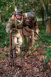 Reenactors dressed in late War German winter clothing both are wearing Parkas and Steel helmets, Short Boots and Gaiters carrying the Mauser K98 Rifle. <br /> <br />  September 2019<br /> All Images Copyright Paul David Drabble - <br /> All rights Reserved - <br /> Moral Rights Asserted -