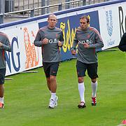 NLD/Katwijk/20110808 - Training Nederlands Elftal voor duel Engeland - Nederland, John Heitinga, Arjan Robben en Joris Mathijssen trainen apart