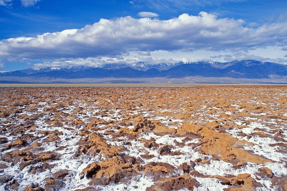 Salt pan under snow-covered Telescope Peak, Death Valley National Park, California
