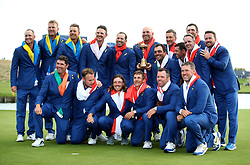 Team Europe's (back left to right), Alex Noren, Robert Karlsson, Henrik Stenson, Justin Rose, Sergio Garcia, Thomas Bjorn, Francesco Molinari, Ian Poulter, Rory McIlroy, Luke Donald, Jon Rahm and Graeme McDowell, (front left to right) Padraig Harrington, Tyrell Hatton, Tommy Fleetwood, Thorbjorn Olesen, Paul Casey and Lee Westwood celebrate with the trophy on day three of the Ryder Cup at Le Golf National, Saint-Quentin-en-Yvelines, Paris.