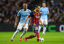 Barcelona Midfielder Xavi (ESP) is challenged by Man City Midfielder Fernandinho (BRA)  - Photo mandatory by-line: Rogan Thomson/JMP - Tel: 07966 386802 - 18/02/2014 - SPORT - FOOTBALL - Etihad Stadium, Manchester - Manchester City v Barcelona - UEFA Champions League, Round of 16, First leg.