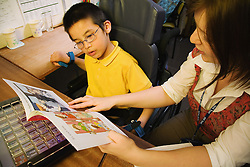 Child with cerebral palsy learning to read,