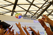 Visitors raise their hands in anticipation of free gifts during a performance by Tencent Games, one of the biggest developers of online games as well as maker of online chatting service QQ, at  the ChinaJoy Expo, also know as the China Digital Entertainment Expo and Conference,  in Shanghai, China on 29 July, 2011. Online and social network games have become hugely popular in China as Chinese children lack the space and facility require for sports, spurning worries from parents and government officials on internet addiction.