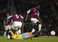 Picture: Henry Browne.<br />Date: 01/10/2003.<br />West Ham United v Crystal Palace Nationwide Division One.<br /><br /><br />West Ham's Jermaine Defoe skips over a challenge from Palaces Michael Hughes