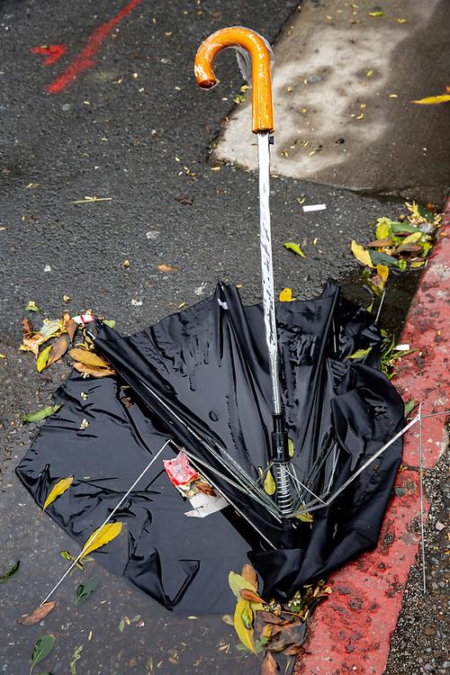 A broken umbrella is left behind near Mission Street on Sunday, Feb. 3, 2019, in San Francisco, Calif.