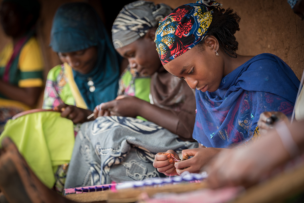 3 June 2019, Djohong, Cameroon: 17-year-old Raihana (right), a refugee from Degaule in CAR is a trainee at a shop in the Borgop refugee camp, as part of a vocational training effort by the Lutheran World Federation's World Service programme, intended to help particularly young refugees make an income. The Borgop refugee camp is located in the municipality of Djohong, in the Mbere subdivision of the Adamaoua regional state in Cameroon. Supported by the Lutheran World Federation since 2015, the camp currently holds 12,300 refugees from the Central African Republic.