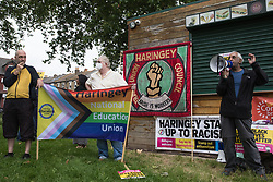 London, UK. 15th July, 2021. A speaker from Stand Up To Racism addresses anti-racist campaigners at an event on Ducketts Common organised by Haringey Stand Up To Racism during which a knee was taken in solidarity with England footballers Marcus Rashford, Jadon Sancho and Bukaya Saka. The three England footballers were subjected to racial abuse following England's Euro 2020 final defeat against Italy.