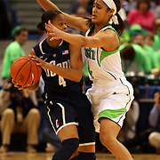 Skylar Diggins, Notre Dame, defending against Moriah Jefferson, Connecticut, during the Connecticut V Notre Dame Final match won by Notre Dame during the Big East Conference, 2013 Women's Basketball Championships at the XL Center, Hartford, Connecticut, USA. 11th March. Photo Tim Clayton