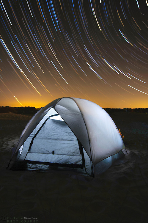 Campsite with tent under the stars at Assateague Island National Seashore, Maryland, USA.