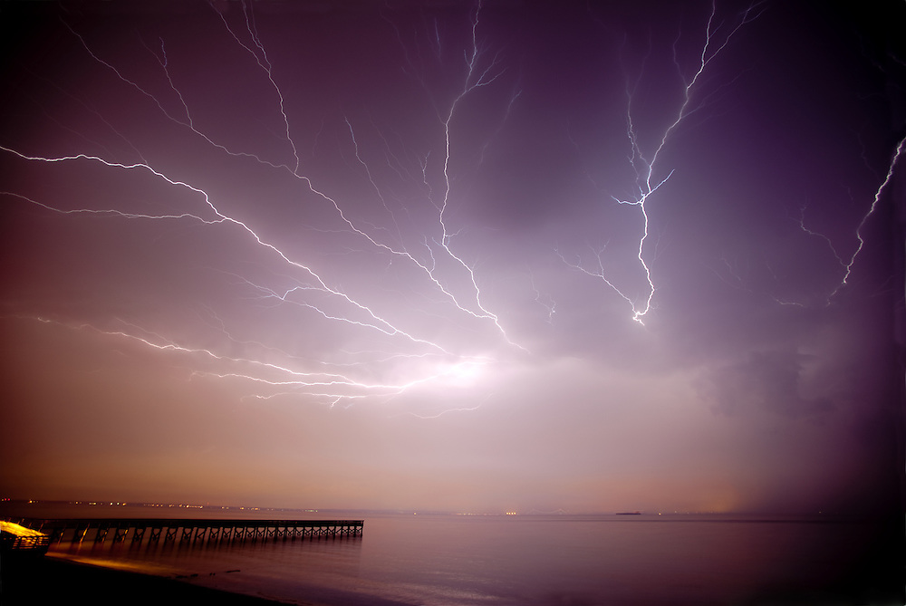 Spider lightning shooting across the sky during a severe thunderstorm seen from the Spy House Fishing Pier Port Monmouth New Jersey.  The severe storm passed across Raritan Bay (New York Harbor) heading toward New York City.