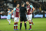 Andy Carroll of West Ham United (r) and Mark Noble, the West Ham United captain arguing with Referee Kevin Friend. Premier league match, West Ham Utd v Manchester city at the London Stadium, Queen Elizabeth Olympic Park in London on Wednesday 1st February 2017.<br /> pic by John Patrick Fletcher, Andrew Orchard sports photography.