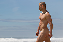 naked man at the ocean
