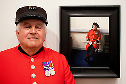 © Licensed to London News Pictures. 20/06/2012. LONDON, UK. Tom, a Chelsea Pensioner, stands next to his portrait painted by artist Louise Pragnell entitled 'Tom, Waiting', hung as one of the featured works at this years BP Portrait Award.  The annual British Petroleum sponsored event runs from the 21st of June to the 23rd of September and highlights the work of portrait artists working in a variety of styles and techniques . Photo credit: Matt Cetti-Roberts/LNP