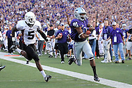 MANHATTAN, KS - SEPTEMBER 05:  Wide receiver Attrail Snipes #81 of the Kansas State Wildcats rushes past free safety Jeromy Miles #5 of the Massachusetts Minutemen for a 40-yard touchdown during the second quarter on September 5, 2009 at Bill Snyder Family Stadium in Manhattan, Kansas.  (Photo by Peter G. Aiken/Getty Images)