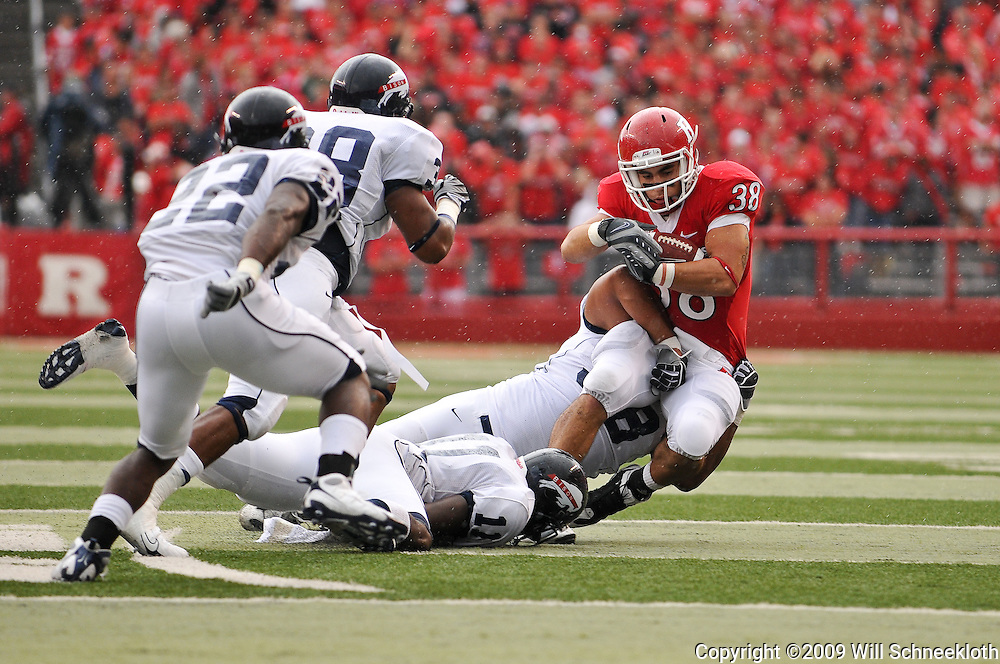 Sep 12, 2009; Piscataway, NJ, USA;  Rutgers running back Joe Martinek (38) is dragged down by Howard defensive tackle Will Croner (98) during the first half of Rutgers' 45-7 victory over Howard in NCAA College Football at Rutgers Stadium.