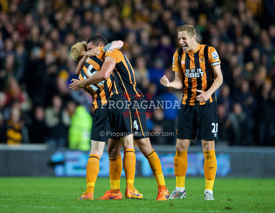 KINGSTON-UPON-HULL, ENGLAND - Tuesday, April 28, 2015: Hull City's Michael Dawson along with Jake Livermore and Paul McShane celebrate the win over Liverpool in the Premier League match at the KC Stadium. (Pic by Gareth Jones/Propaganda)