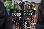 """Berlin, Germany - 20.05.2018<br /> <br /> Police eviction of the occupation. With several occupations, activists responded to speculative home vacancy. The biggest action took place in Berlin-Neukoelln. There, a residential building with about 40 apartments was occupied, empty for about 5 years. The building belongs to the state-owned housing company """"Stadt und Land"""". During the negotiations between representatives of the Berlin Senate, the Stadt und Land"""" and the squatters the police evict the building. The situation on the Berlin housing market is very tense.<br /> <br /> Polizeiliche Raeumung der Besetzungsaktion. Mit mehreren Besetzungen haben Aktivisten an Pfingsten auf spekulativen Leerstand Reagiert. Die groeßte Aktion fand in Berlin-Neukoelln statt. Dort wurde ein Wohnhaus mit rund 40 Wohnungen besetzt, welche seit etwa 5 Jahren leer stehen. Das Gebaeude gehoert der landeseigenen Wohnungsgesellschaft """"Stadt und Land"""". Noch waehrend Verhandlungen zwischen Senatsvertretern, der Stadt und Land und den Hausbesetzern liefen begann in den Abendstunden die polizeiliche Raeumung.  <br /> <br /> Photo: Bjoern Kietzmann"""