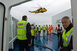 Licensed to London News Pictures. 25/11/2006. LIBRARY PICTURES. North Sea, UK, Operation 'Mallards Saviour' - a massive exercise carried out off Tynemouth, North Tyneside  by the MCA, Fire Brigades, RAF and Marine Incident Response Group (MIRG) to simulate the response to a fire onboard a major vessel at sea - takes place on board the DFDS ferry King of Scandinavia, the same vessel, now named King Seaways that suffered a blaze at sea this evening off the Yorkshire coast.  The exercise was centred around RAF Rescue helicopters from 202sqn ferrying firefighters onboard to supplement the vessel's crew's own firefighting capabilities. The Marine Incident Response Group (MIRG) was discontinued in April 2012. Photo credit: Adrian Don/LNP