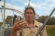Betty Osceola, a member of the Miccosukee tribe and Panther clan on an airboat in the Everglades.