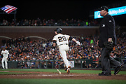 San Francisco Giants catcher Buster Posey (28) runs to first base on a single against the Los Angeles Dodgers at AT&T Park in San Francisco, California, on April 24, 2017. (Stan Olszewski/Special to S.F. Examiner)