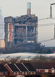 © Licensed to London News Pictures. 24/02/2016. Didcot, UK. A view over the town of Didcot in Oxfordshire shows a scene of wreckage where three workers are missing and one died when an explosion caused part of Didcot power station in Oxfordshire to collapse. The site was undergoing preparation for demolition in the coming weeks.   Photo credit: Peter Macdiarmid/LNP