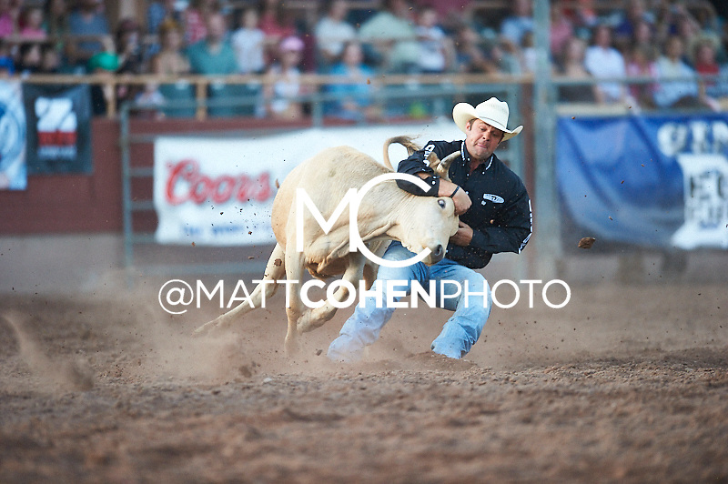 Steer wrestler Bray Armes of Ponder, TX competes at the Pikes Peak or Bust Rodeo in Colorado Springs, CO.<br /> <br /> <br /> UNEDITED LOW-RES PREVIEW<br /> <br /> <br /> File shown may be an unedited low resolution version used as a proof only. All prints are 100% guaranteed for quality. Sizes 8x10+ come with a version for personal social media. I am currently not selling downloads for commercial/brand use.